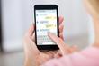 Leinwandbild Motiv Person Sending Text Message Using Mobile Phone