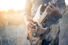 Musician With Guitar At Sunset Field, Music Background, Vintage