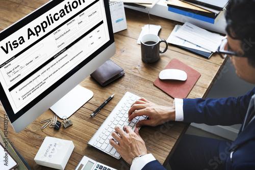 Fotografie, Obraz  Business Man Working Visa Application Form