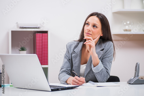 Young businesswoman is working in her office.