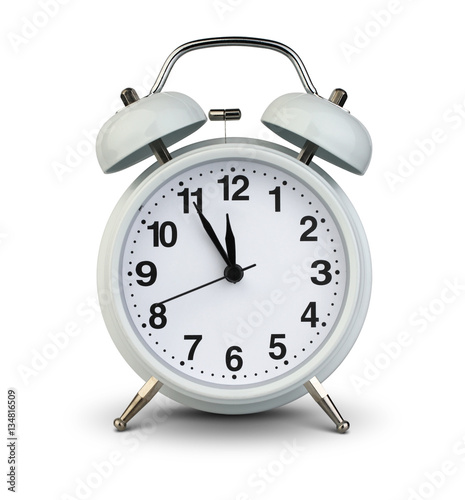 alarm clock isolated on white clipping path five minutes to tw