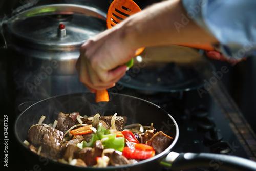 Foto op Plexiglas Koken Cooking meat with a vegetables
