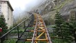 The rise of the funicular into mist by the passenger's eyes