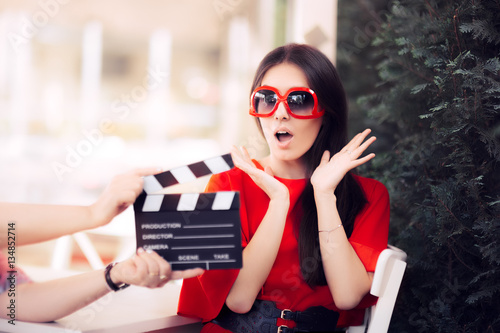 Photo  Surprised Actress with Oversized Sunglasses Shooting Movie Scene