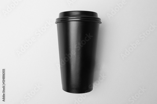 Wall Murals Cafe Blank black paper cup on the grey background