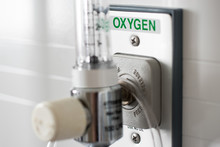 O2 Pressure Gauge For Measured Control Of Oxygen To A Patient In An Emergency Used In Hospital Equipment Plugged Into The Wall With Clear Glass Valve