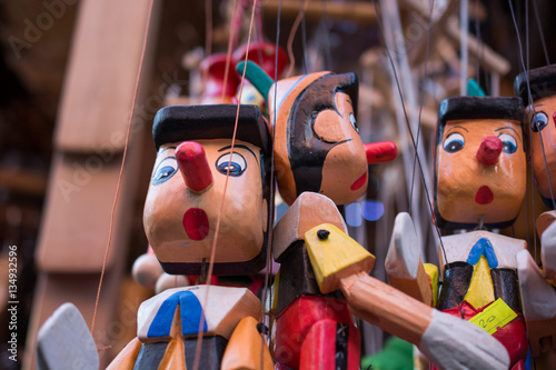Wooden pinocchio dolls with his long nose Canvas Print