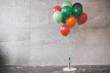 Bunch Of Color Balloons On Gray Wall Background.