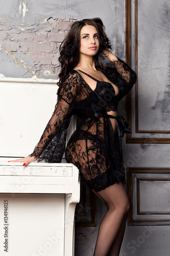 661bf0ec1ff fashion sexy young woman in black lacy lingerie and stockings posing on  piano