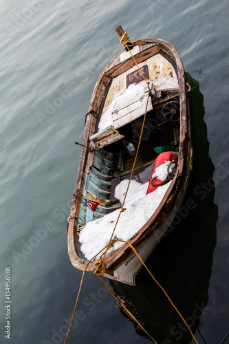 Canvas Print Fishing boat in the waters of sea