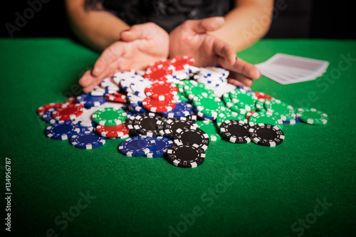Poker player going all in Canvas Print