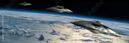 A fleet of flying saucers approach Earth - Elements of this image furnished by NASA Canvas Print