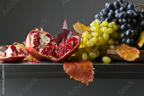 Blue and white grapes with pomegranate Canvas Print