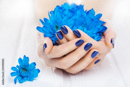 Printed kitchen splashbacks Manicure blue manicure with chrysanthemum flowers. spa