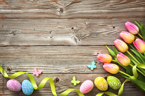 Easter background with colorful eggs and spring tulips Wallpaper Mural