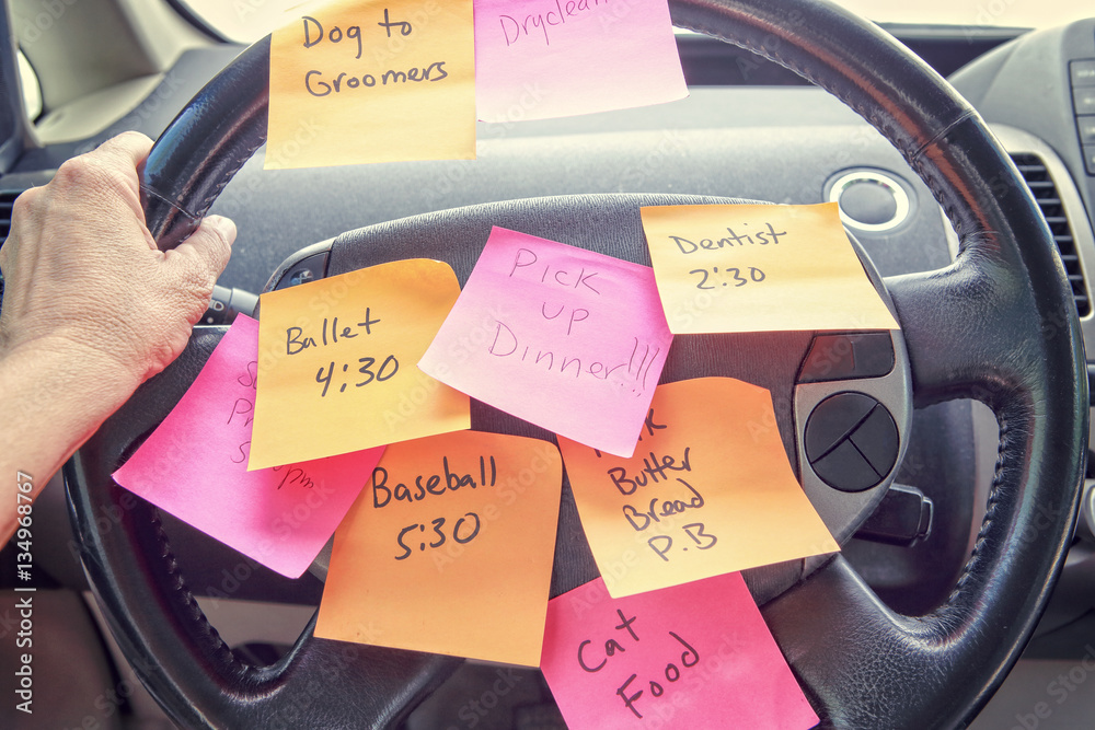 Fototapety, obrazy: Steering wheel covered in notes as a reminder of errands to do