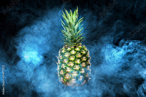 Pineapple fruit on background with vape smoke - 134970122