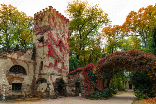 Photo Arkadia, Poland - September 30, 2016: Burgrave's house and stone arch in the  sentimental and romantic Arkadia park,  near Nieborow, Central Poland, Mazovia