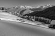 canvas print picture - Alm - und Schihütten in den verschneiten Alpen in schwarz weiss