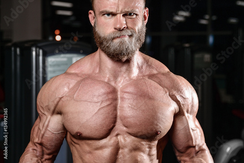 Fotografie, Obraz  brutal muscular man with beard unshaven fitness model healthcare
