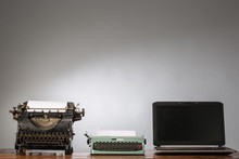 Vintage Typewriter And Laptop. New And Old Typing Machines.