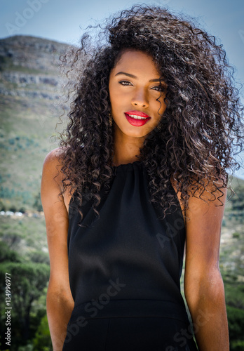 Black Young Woman With Curly Hair And Big And Beautiful Red