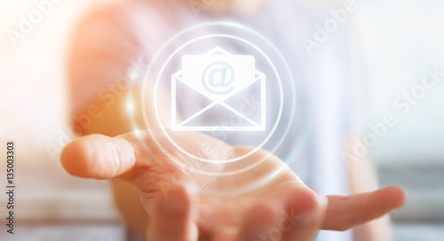Businessman holding 3D rendering flying email icon in his hand