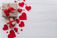 Valentine's Day. Presents, Heart Felt And Decor On Wooden Background