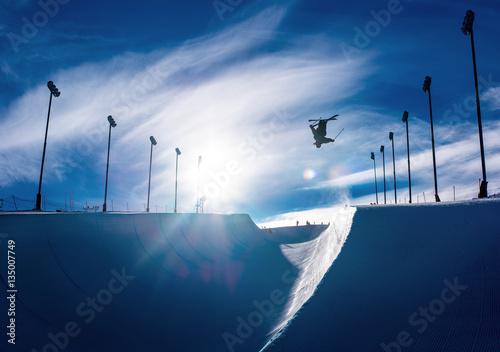 Fotografie, Obraz  Skier doing an inverted trick in winter snow halfpipe