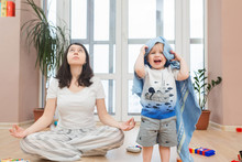 Portrait Of Young Happy Yoga Mom Spending Time With Her Little Baby Boy