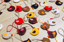 Handmade Felt Owl Toy,  Sheets, Scissors, Thread, Pins, Needle On A Brown Wooden Background
