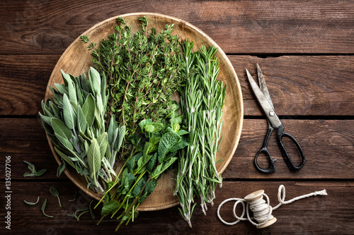 various fresh herbs, rosemary, thyme, mint and sage on wooden background Poster