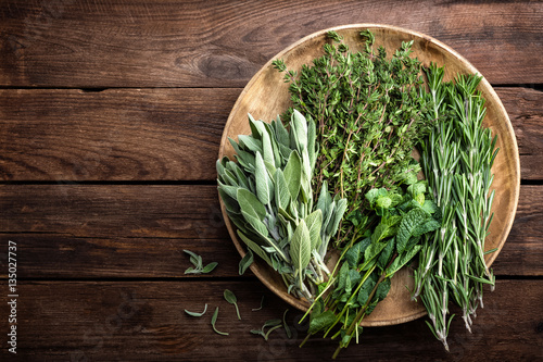 Recess Fitting Condiments various fresh herbs, rosemary, thyme, mint and sage on wooden background