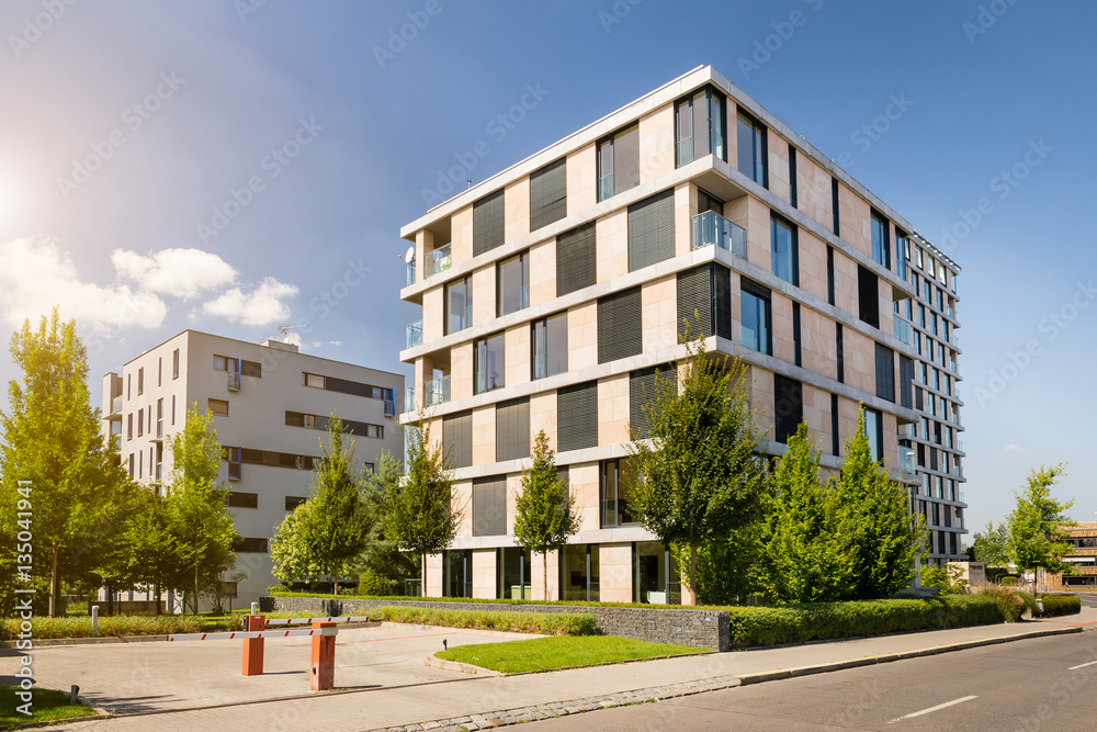 Fototapeta View of modern block of flats with blue sky