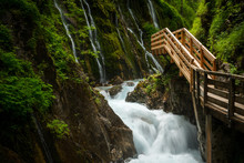 Green Canyon With New Wooden Footpath. Wild Gorge With Mountain Stream.