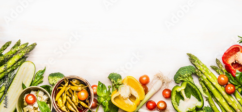 Deurstickers Keuken Variety of organic vegetables ingredients with asparagus and feta for delicious seasonal cooking , white wooden background, top view, place for text, banner