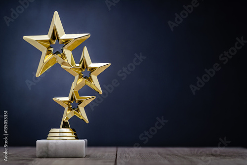 Fotografía  Gold winners award with three stars