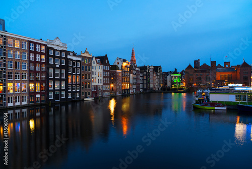 Photo  Houses over canal with mirror reflections at blue night, Amstardam, Netherlands