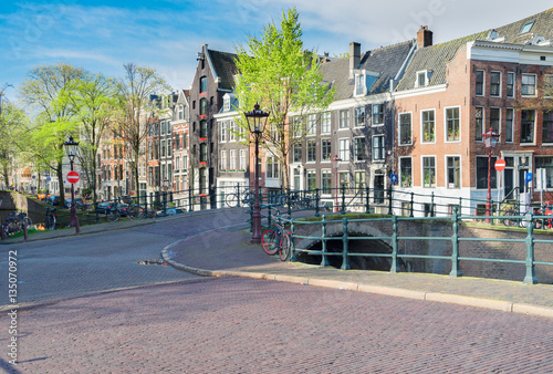 Photo  Street in old town with historical houses, Amstardam, Netherlands