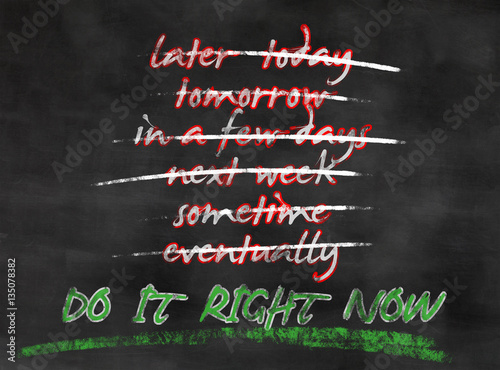 blackboard with concept do not procrastinate but take action now