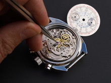 Close Up Of Watchmaker Adjusti...