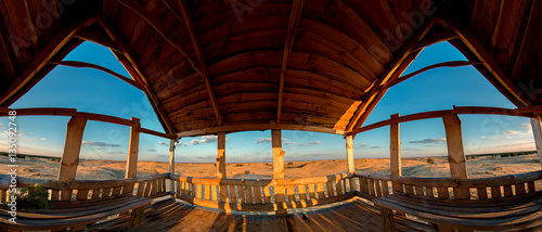 Wooden lookout alcove overlooking the sandy desert Canvas Print
