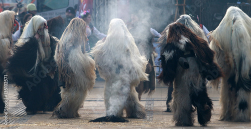 Poster Oost Europa PERNIK, BULGARIA - JANUARY 29, 2017 - Masquerade festival Surva in Pernik, Bulgaria. People with mask called Kukeri dance and perform to scare the evil spirits