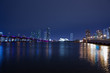 View on Miami Downtown and MacArthur Causeway at night time with a view on a bay, Sunset. USA