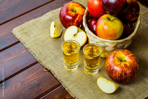 Photo  Apple brandy shots and red apples