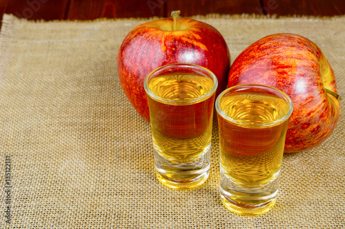 Photo  Two schnapps drinks and red apples