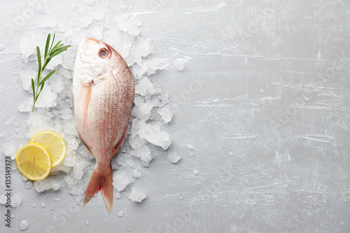 Poster Fish Fresh red Japanese seabream cooking on gray stone background, top view