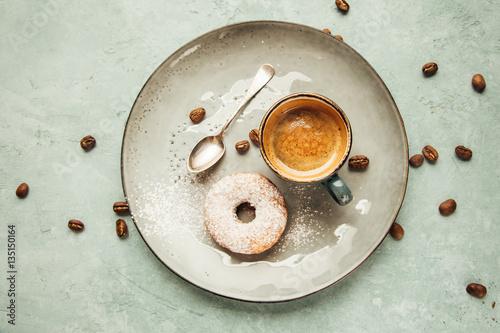 Coffee and homemade doughnut.