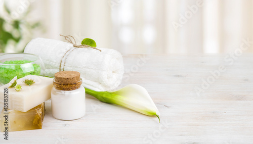 Spa wellness products on light wooden background with copy space