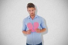 Composite Image Of Sad Man Holding A Broken Heart